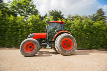 Man with tractor in a garden, blurred motion