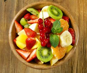 Fresh organic fruit salad (kiwi, strawberry, banana, currant)