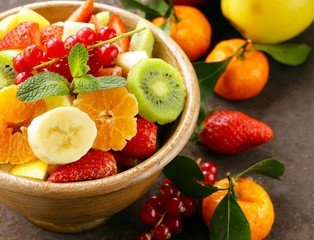 Fresh organic fruit salad (kiwi, strawberry, banana, currant)