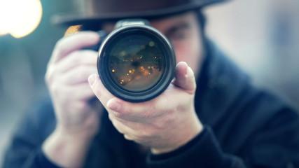 man takes a photo