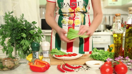 Female hands slicing red tomato, dolly shot