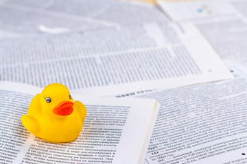 hoax symbol with rubber duck and newspaper