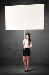 Businesswoman with blank whiteboard