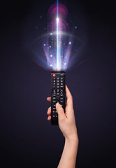Hand with remote control and shining numbers