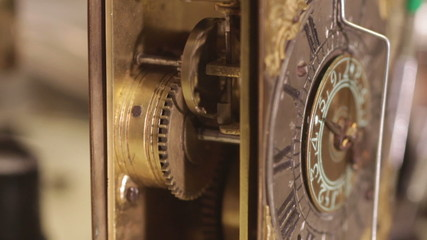 watchmaker winding a antique clock to make it sound_WITH AUDIO