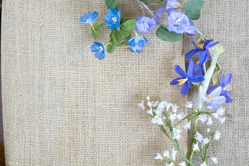 small bunch of artificial flowers on background