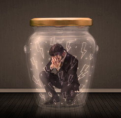 Businessman inside a glass jar with lightning drawings concept
