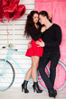 Beautiful couple in love with red balloon heart shape for valent