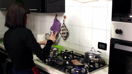 italian woman preparing condiment for pasta
