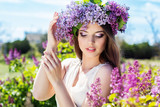 Beautiful girl with a lilac flowers