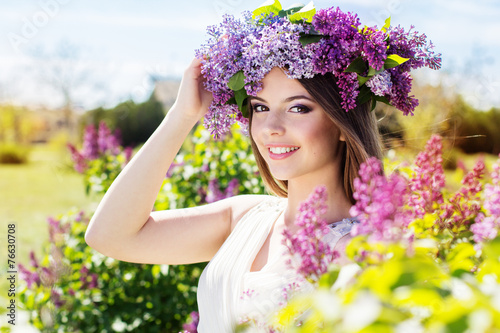 Beautiful girl with a lilac flowers - 76630708