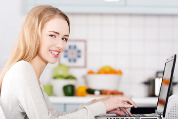 Young woman using a laptop computer at home