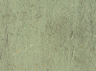 Cracked light green paint