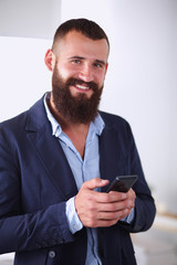 Close up of a man using mobile smart phone, isolated on white