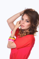 Beautiful woman with curly hair wearing a red jacket, isolated