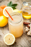 Fototapeta Healthy drink made of  lemon, cinammon, ginger and honey