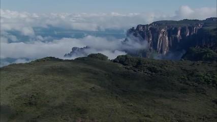 Mountains Ridge Cliffs Clouds