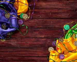 Mardi Gras: Colorful Cloths And Party Trinket Background