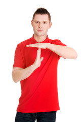 Handsome man showing time out sign