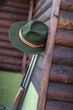 Picture of hunters rifle with hat. - 76635356