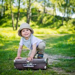 small child on a suitcase