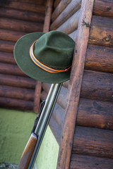 Picture of hunters rifle with hat.