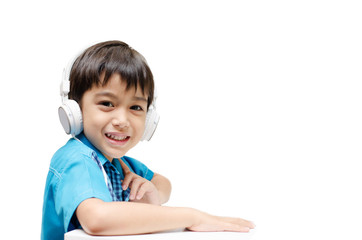 Little boy learning with headset on ear