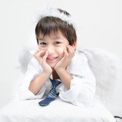Little boy portrait pretend as cupid with wing