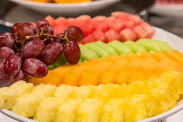 Sliced Pineapple and Melon with Grapes