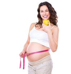 Pregnant woman measuring her big pregnant belly