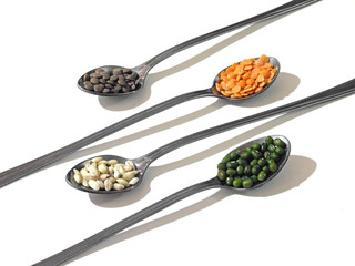 Legumes and cereals on long-handled teaspoons