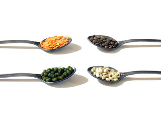 Legumes and cereals on long handled teaspoons