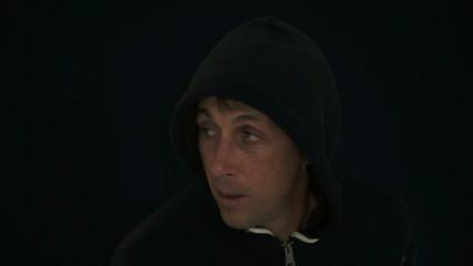 Suspicious Man Wearing a Black Hoodie