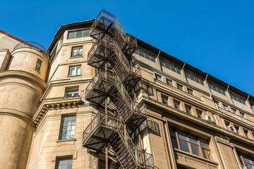 Metal Fire Escape Stairs On Old Building Facade