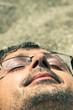 Closeup of man sleeping on the beach