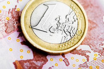 coin one euro at EUR 10 banknote