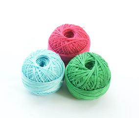 thread balls on white background