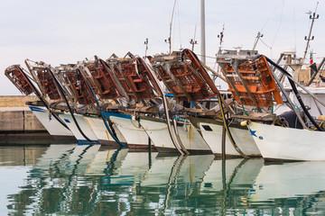 fishing boats moored at the harbor