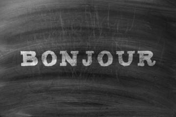 Word Bonjour Written On Blackboard
