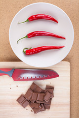 Chili peppers with chocolate and knife