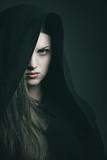 Beautiful vampire with black robe