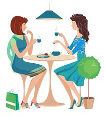 Two fashion girls chatting at a cafe