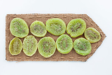Pointer of  burlap with dried kiwi