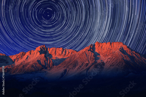 Foto op Canvas Nacht Night Exposure Star Trails of the Sky in Bishop California