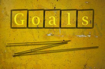 goals written on a wall background