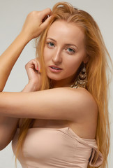 Sexy blonde woman with long hair and natural make-up