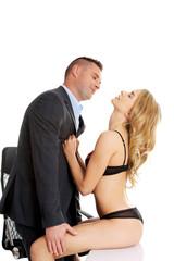 Seductive woman and man - office romance concept