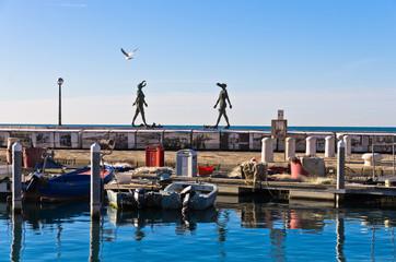 Piran harbor with symbolic statues of Tartini theatre, Istria