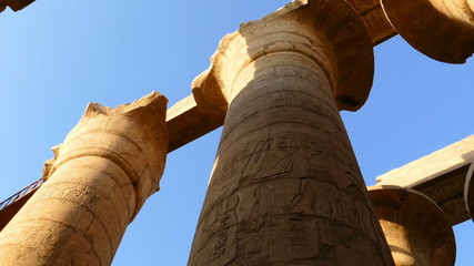 top of columns in karnak temple with ancient egypt hieroglyphics