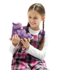 child holding a shoe
